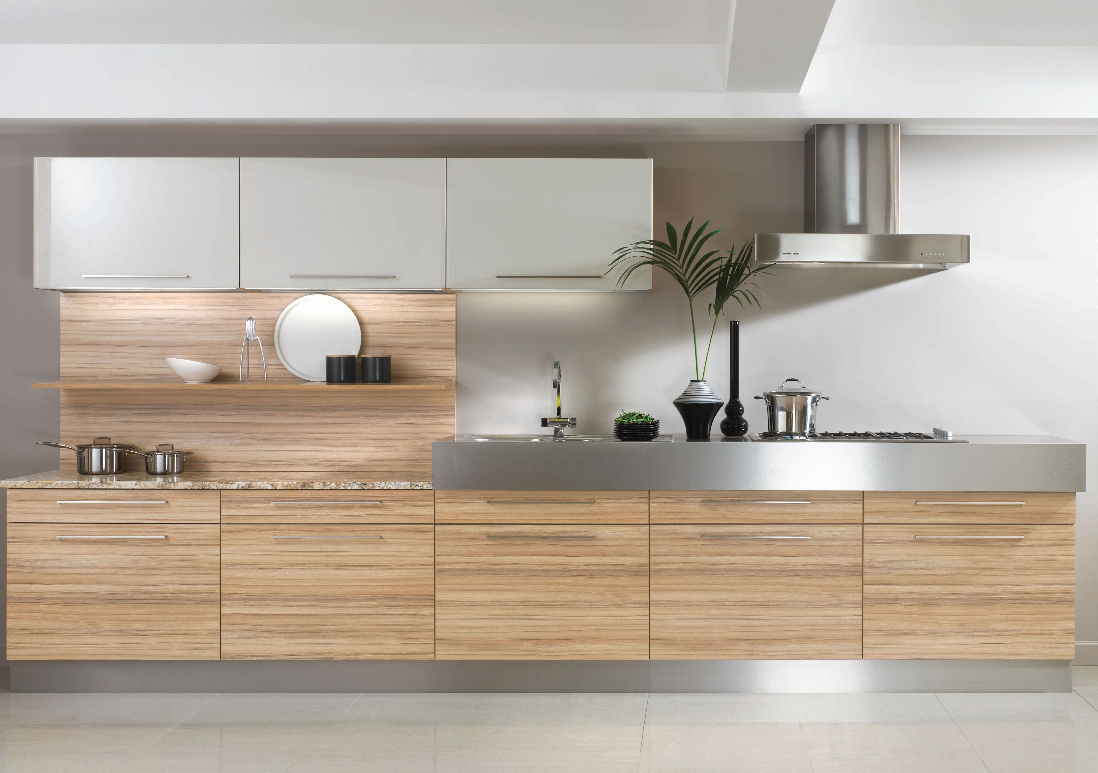 Coco Bolo kitchen units bined with stainless steel worktops for a modern but very practical kitchen design