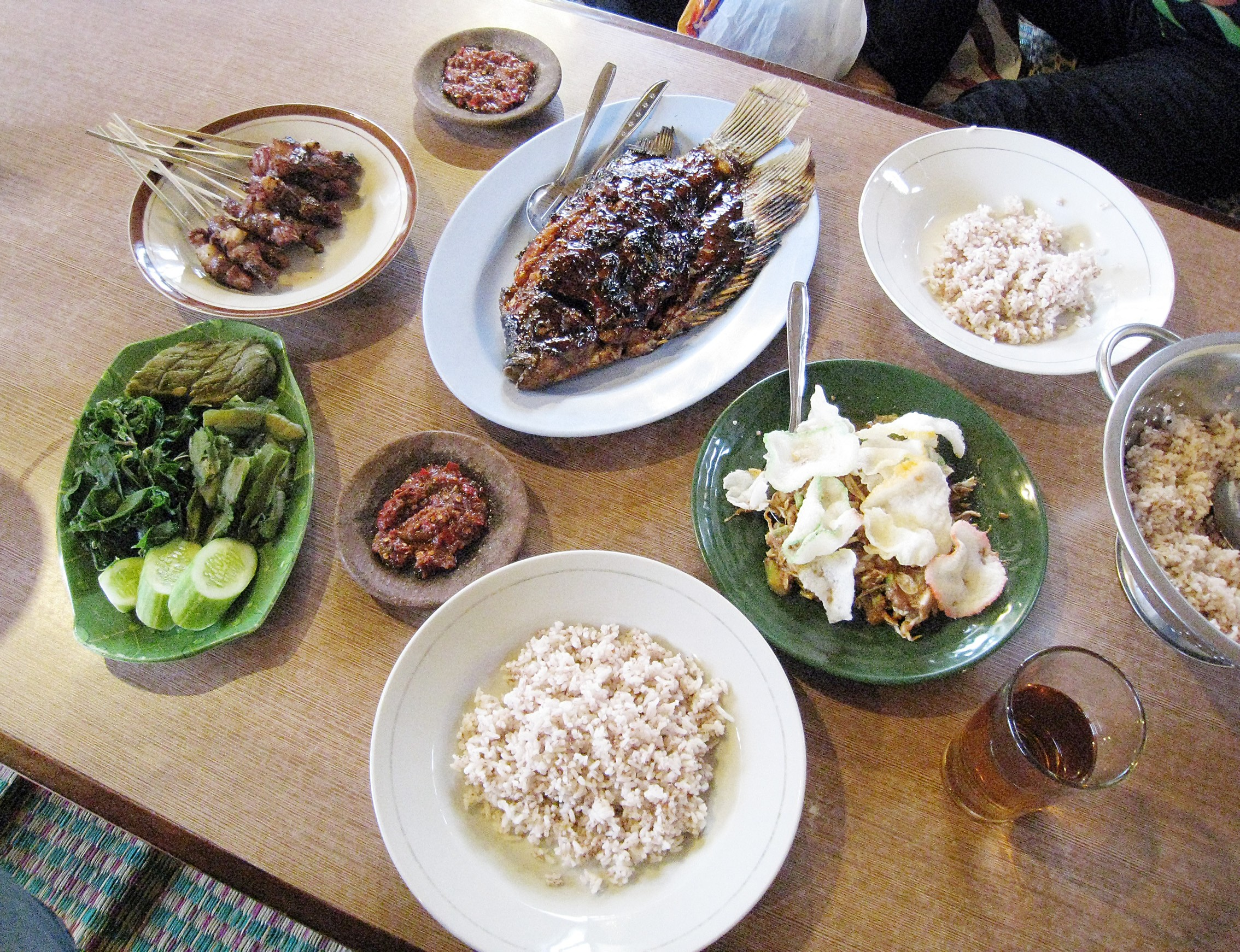 Indonesian typical munal meal consist of nasi steamed rice lauk pauk fish and meat side dishes and sayur mayur ve ables author Gunawan